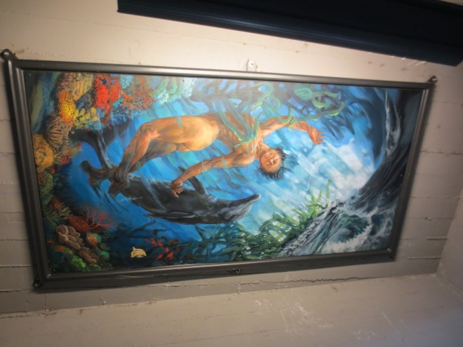 "I followed a sign that pointed to a garden under a bridge in Ashland. The sign read, ""This is The Path to Joy and Unity. Open your heart, and contemplate the magic that you will view."" This painting was among many mounted like frescos on the ceiling underneath the bridge."