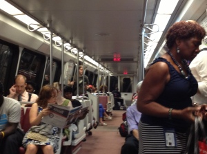 Forth Stop: Black people begin to leave the train. More white people get on.